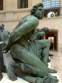 A photo from the Louvre of a buff statue